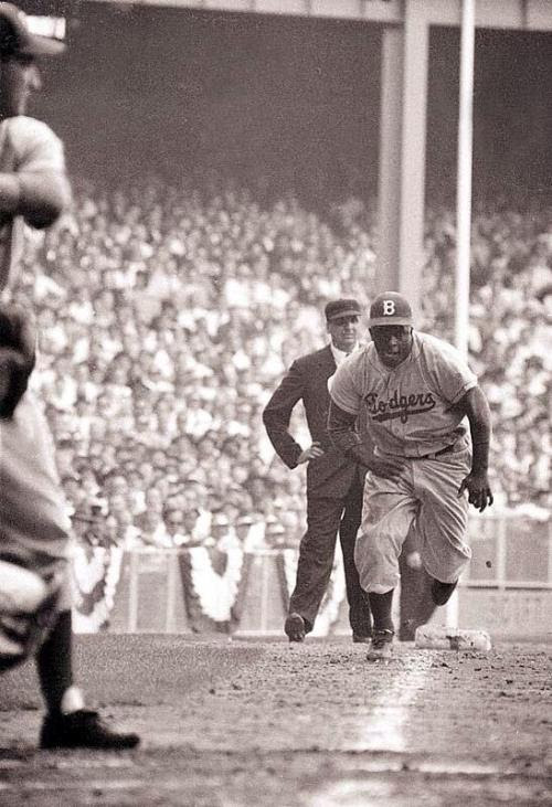 Jackie Robinson on his way toward stealing home. Game 1 of '55 Series.