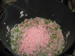 Adding the three ground meats: res, puerco, jamon