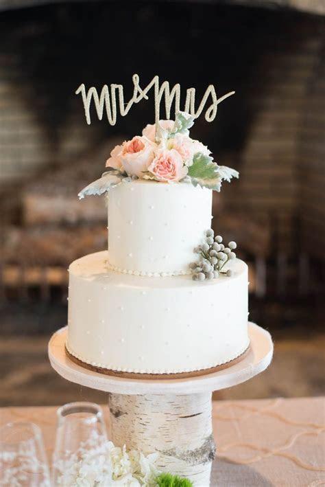 small white wedding cake   The Celebration Society