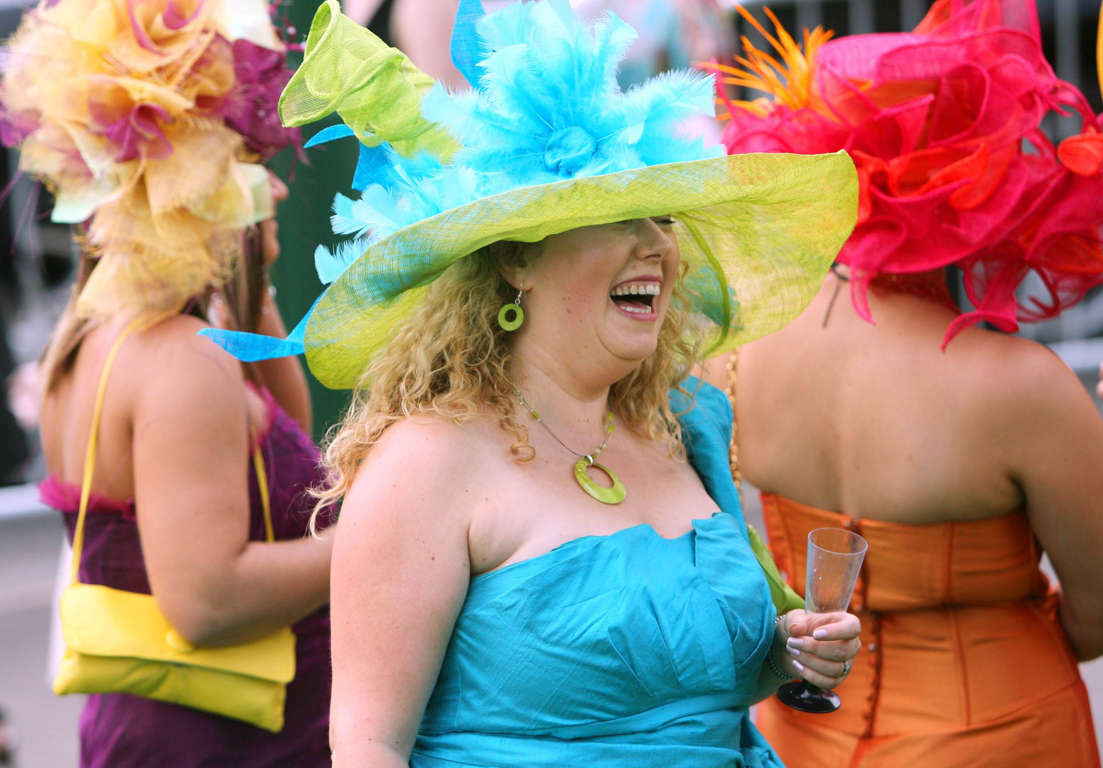 A visitor laughs at the Royal Ascot 2007 horse races in Ascot, U.K., Tuesday, June 19, 2007. Photographer: