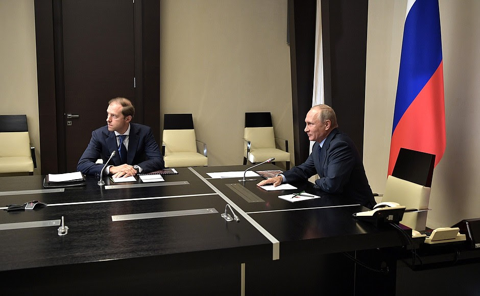 ThePresident listened toareport via videoconference onthedestruction ofRussia's last remaining chemical weapons. With Minister ofIndustry andTrade Denis Manturov.