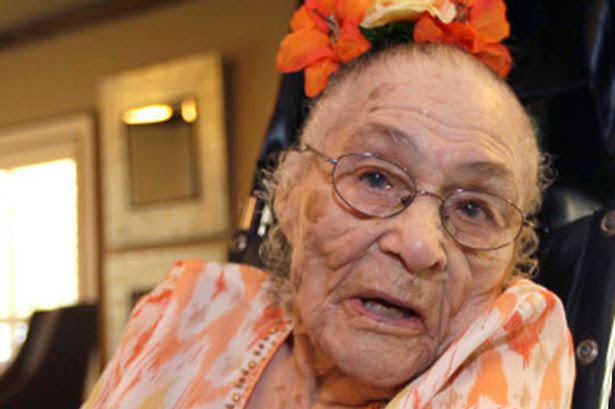 Gertrude Weaver poses at Silver Oaks Health and Rehabilitation Center in Camden, Ark., a day before her 116th birthday