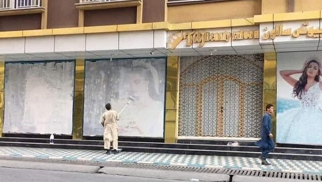Even before Taliban could cement its political footprint in Afghanistan, Islamic fighters could be seen erasing testaments of development and how far Kabul had come in terms of normalising women's lives. capital Kabul is already facing a grim makeover. Posters of women on showro@MalikAchkJourno