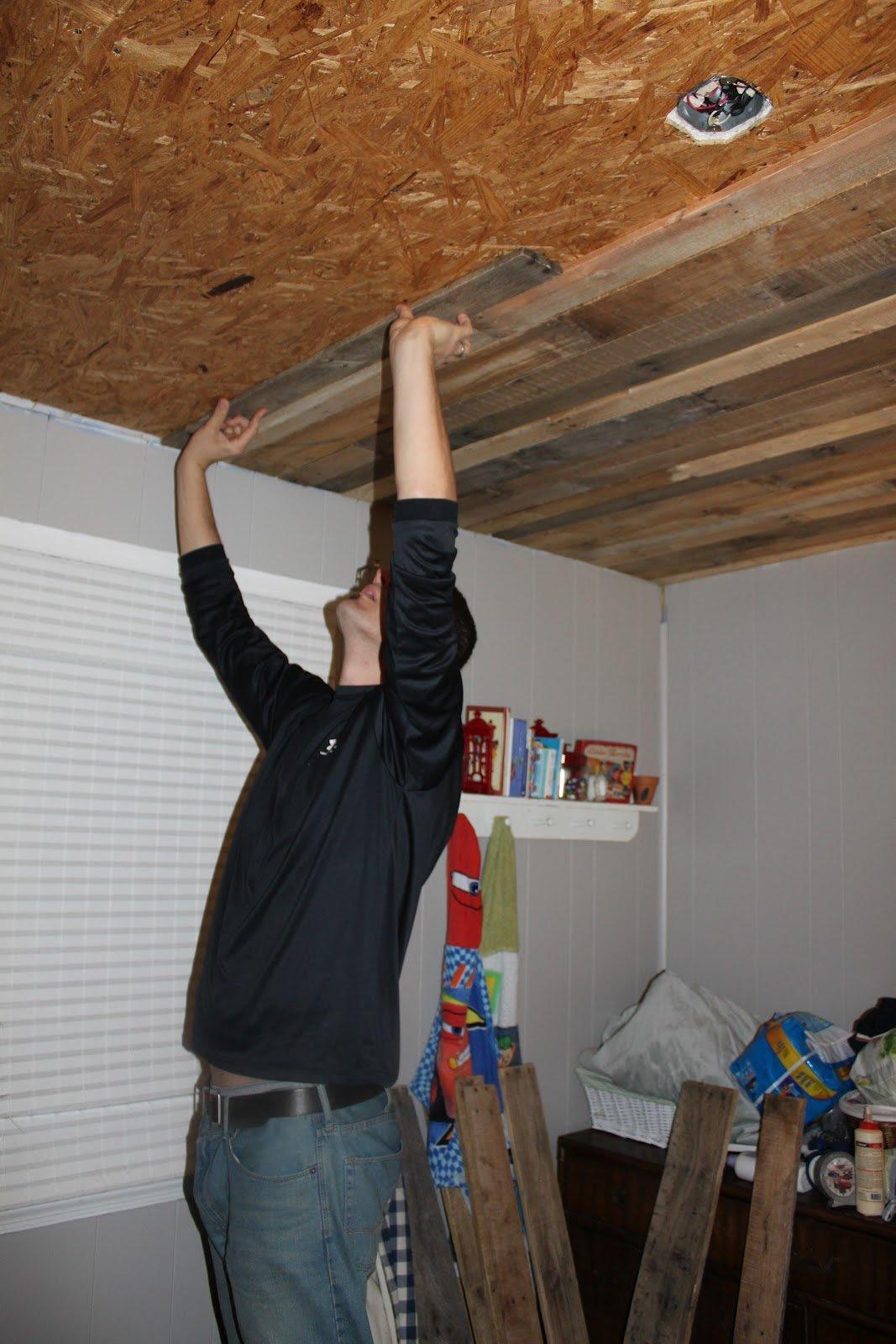 Remodelaholic | Rustic Pallet Wood Ceiling Tutorial