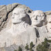 A visitor took a picture of Mount Rushmore from outside the park on Tuesday, the first day of the federal government shutdown, which closed all national parks.