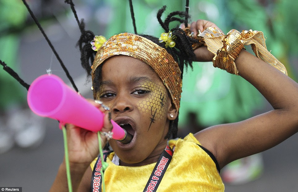 Instruments are out: A child blows a vuvuzela