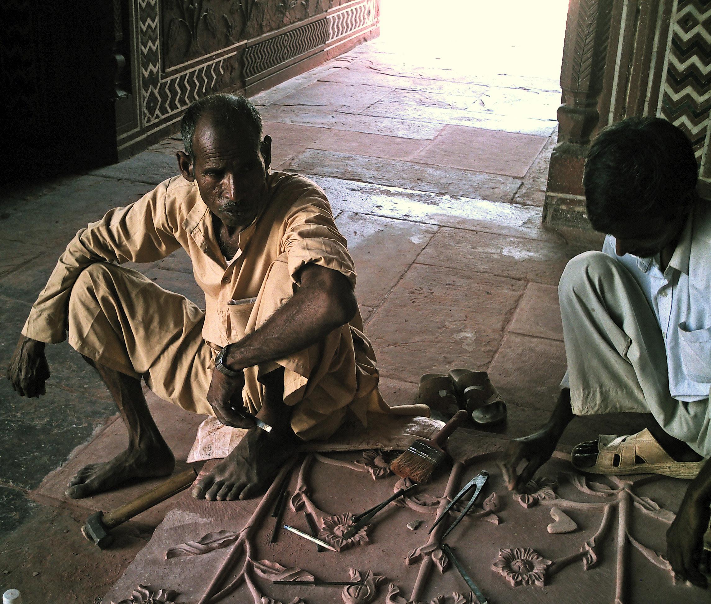artisan repairing artwork