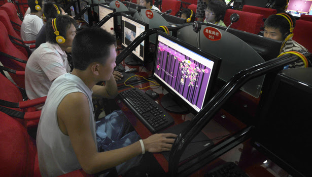 A customer looks at a web page of Qzone, a Chinese social networking site at an internet cafe in Changzhi, Shanxi province August 28, 2009. From virtual clothes to e-pets, Asians spend an estimated $5 billion a year on virtual purchases via websites such as Qzone, Cyworld in South Korea and mobile-phone based network Gree in Japan, according to Plus Eight Star. That's about 80 percent of the global market for virtual products, it says. To match feature ASIA-SOCIALNETWORKING/   REUTERS/Stringer (CHINA BUSINESS SOCIETY SCI TECH) CHINA OUT. NO COMMERCIAL OR EDITORIAL SALES IN CHINA