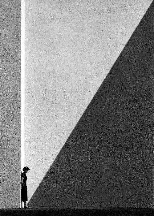 seensense:  Approaching Shadow, Hong Kong, 1956/2012,Fan Ho.From Hong Kong Yesterday.  The person who took this photograph is focusing on the approaching shadow. But when I look at this picture, all I see is a woman standing alone. One picture = different perspectives