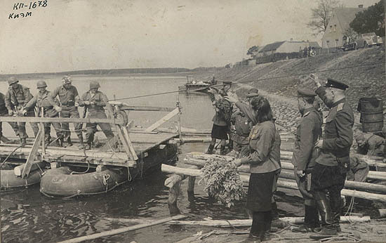 "Americans on the raft (from left to right) are Bob Haag, Ed Ruff, Carl Robinson and Byron Shiver. This photo appeared in the ""Komsomolskaya Pravda"" issue shown above."