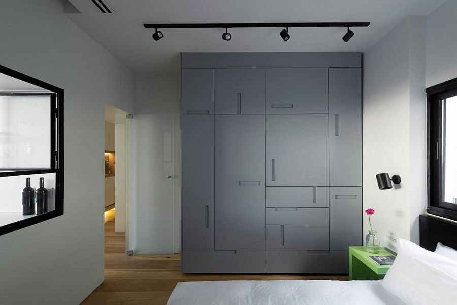 Custom bedroom wardrobe with uniquely placed handles