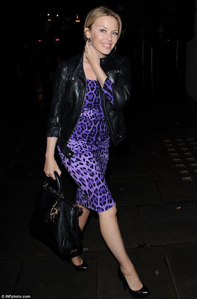 Pretty in purple: Kylie Minogue as she makes her way to a performance of Carbon Life in London