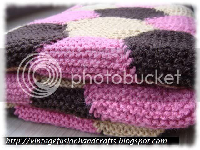 folded hand knitting throw