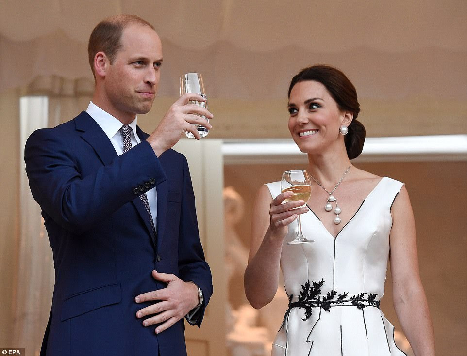 Cheers!The Duchess of Cambridge wore a black and white ensemble with a plunging neckline, adorned with asymmetric black piping and topped off with an old pearl necklace and her trusty Gianvito Rossi pumps, for the garden party in Warsaw