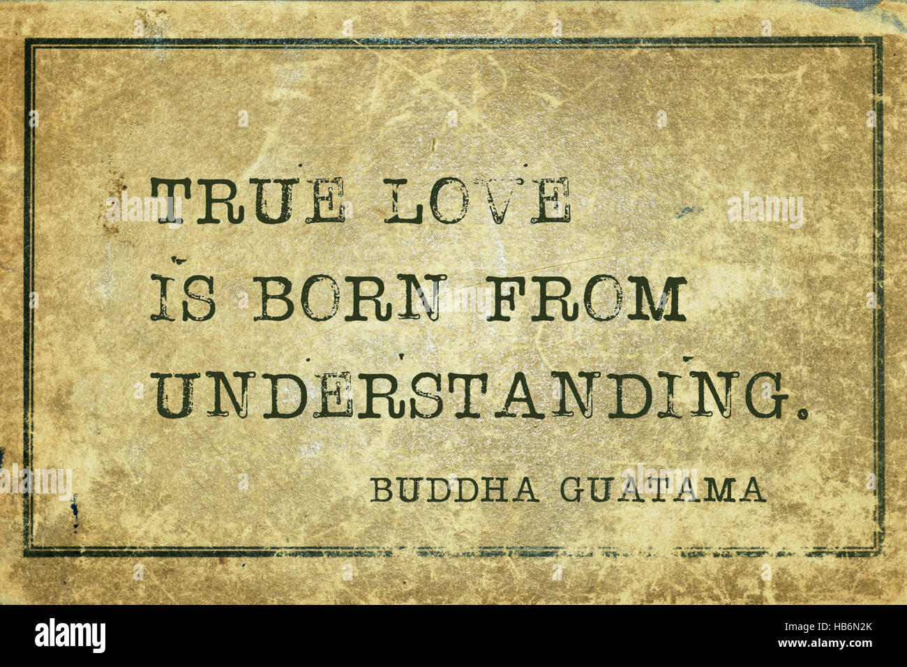 Stock True love is born from understanding famous Buddha quote printed on grunge vintage cardboard