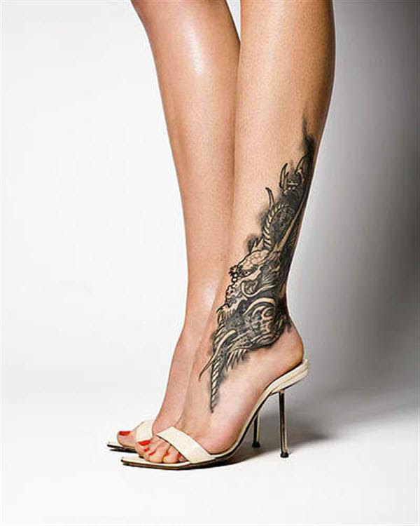 Grey Ink Dragon Tattoo On Foot For Women