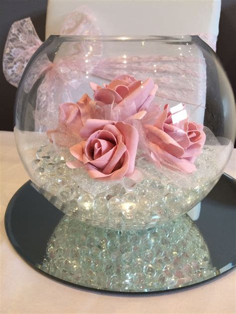fish bowl wedding centrepiece with pink roses. Hire in
