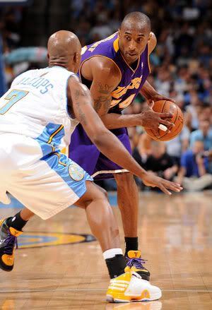 Kobe Bryant squares up against Chauncey Billups of the Denver Nuggets in Game 6 of the Western Conference Finals on May 29, 2009 in Denver, Colorado.