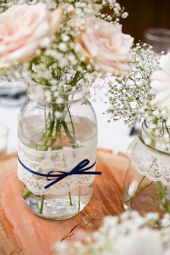 Could easily DIY this. Love just the lace and ribbon around the jar. With royal blue and gray/silver ribbon. Lace mason jar vases - large quart size - set of 12. $60.00, via Etsy.