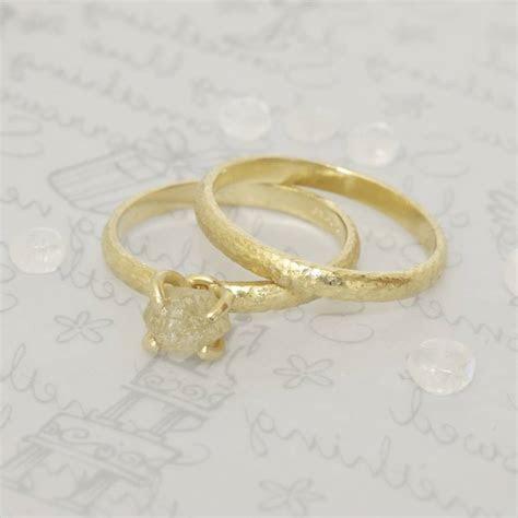 18 carat gold textured wedding ring by caroline brook