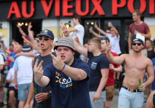 English football fans taunt French fans in the Olde Town area in Marseille
