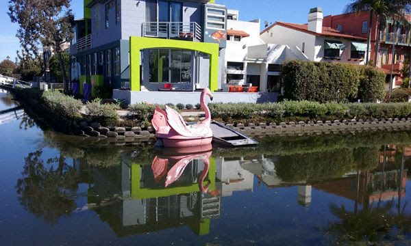A pink flamingo boat that's docked near a condo in the Venice Canal Historic District...on January 30, 2017.