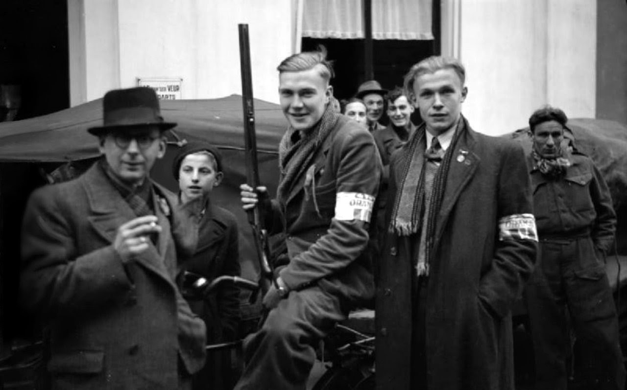 Members of the Dutch Resistance band together to search for any German soldiers and Dutch collaborators remaining in the area after British troops liberatedthe city. Winterswijk, Achterhoek, Gelderland, Netherlands. 1 April 1945.