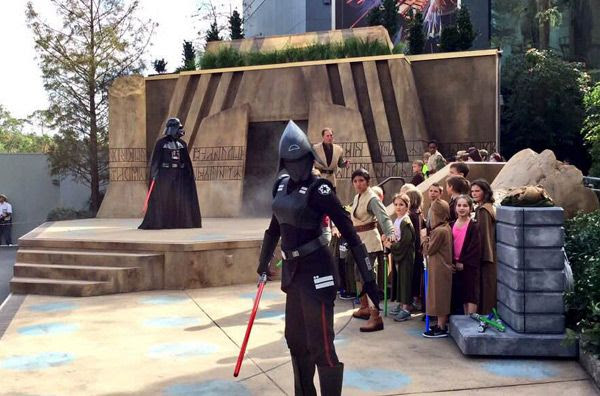 Disneyland Cast Members dressed as Darth Vader and the Seventh Sister.