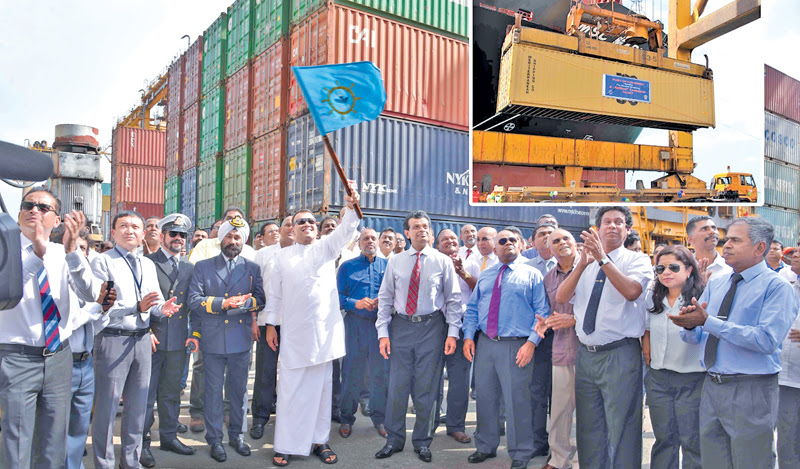 Ports and Shipping Minister Mahinda Samarasinghe signalling to handle the six millionth TEU of the Port of Colombo brought in by MV MSC Madhu B at the Jaya Container Terminal. SLPA Chairman Dr. Parakrama Dissanayake and Director (Operations) Jayantha Perera were present.