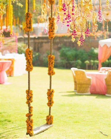 Beautiful floral decorated swing for mehndi decor