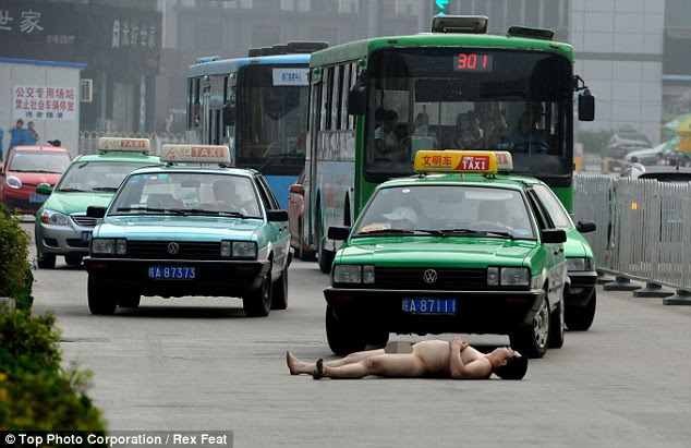 The last stand: Before long, he whipped off his boxer shorts and laid down in the road for his final act