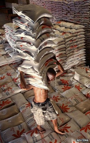 Man carrying rice in warehouse
