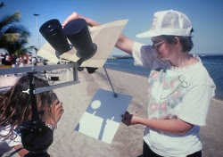 You can mount binoculars on a tripod, cover one lens with a lenscap and project the sun's image safely onto a sheet of white cardboard. Credit: Bob King
