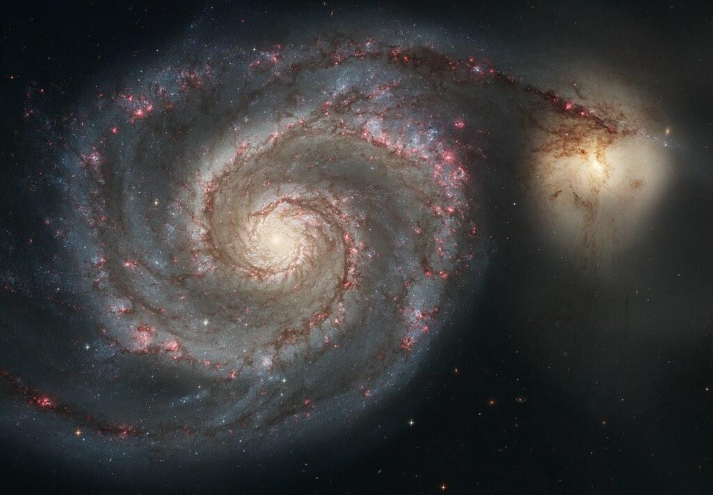 http://upload.wikimedia.org/wikipedia/commons/thumb/d/db/Messier51_sRGB.jpg/1024px-Messier51_sRGB.jpg