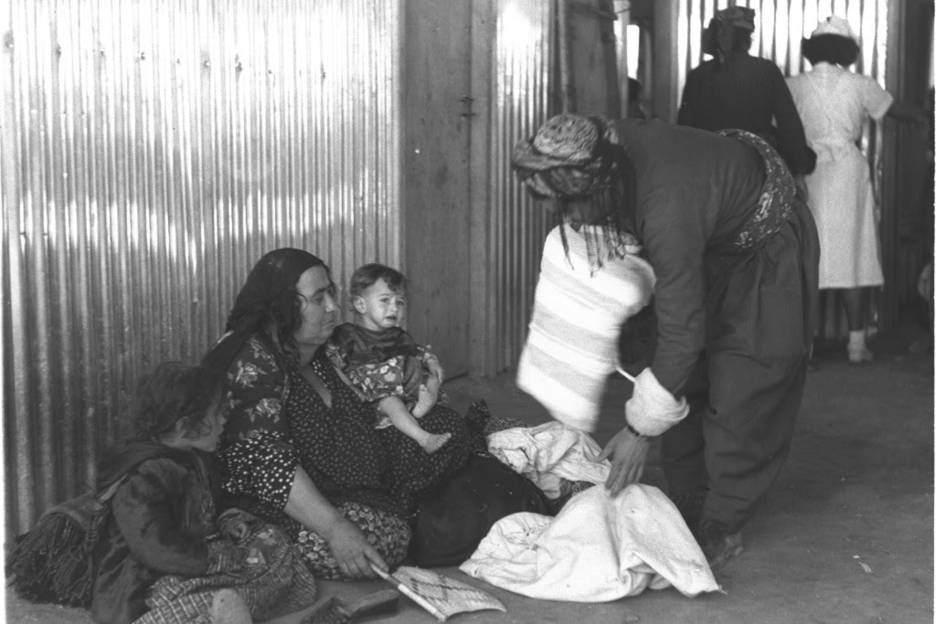 An Iraqi Jewish family packs before leaving the country, 1951. Photo: Teddy Brauner / Wikimedia