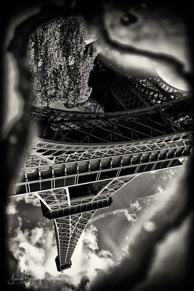 The Eiffel Tower Hiding in a Paris Puddle Under the Tower - Click for full sized Hi-Res Image - JohnBrody.com -  JohnBrody.blogspot.com