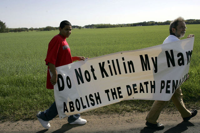 "Two men with large sign: ""Do not kill in my name. Abolish the death penalty"""