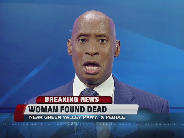Woman found dead behind shopping center