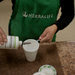 A distributor of Herbalife, the seller of nutritional supplements, mixes a drink in Queens, New York.