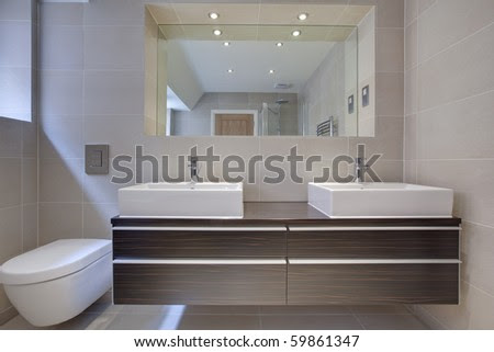 Modern Bathroom Detail With Twin Sinks. Built-In Cupboard And ...