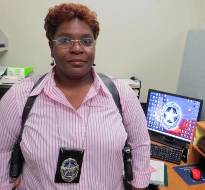 The Rev. Doris Smith is a full-time Dallas police detective, assigned to the traffic division, where she investigates hit-and-run cases and others involving vehicles. On Sundays, and once or twice during the week, she's at Warren Chapel United Methodist Church, in Terrell, Texas, where she's part-time pastor. Photo by Sam Hodges, UMNS.
