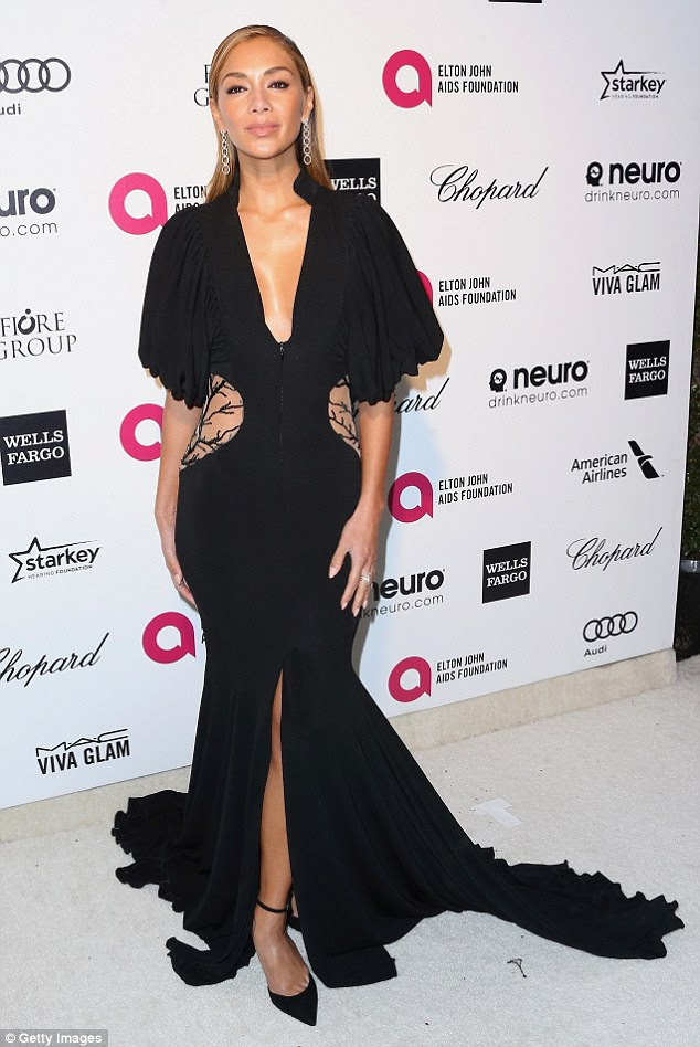 Standing out for all the right reasons: Nicole looked amazing in the slinky black floor length gown
