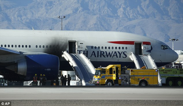One side of the plane was damaged in the fire. The evacuation slides are still deployed