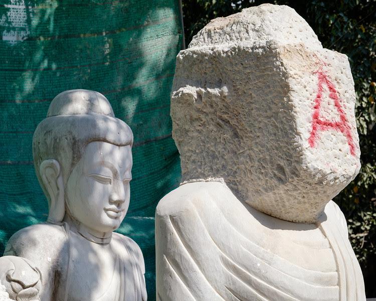 Marble buddha waiting for a head