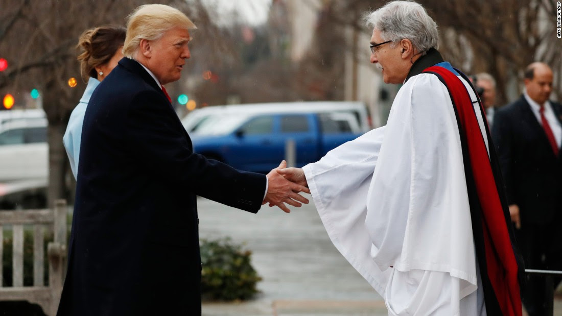 The Rev. Luis Leon greets the Trumps on their arrival for the service at St. John's.