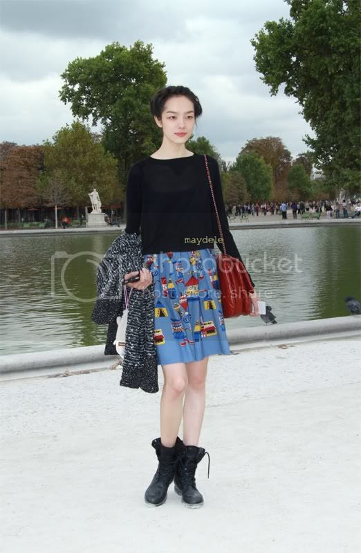 Fei Fei Sun wearing Chanel and printed skirt