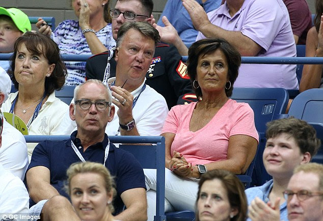 The former Manchester United manager was sat next to his wife Truus, right