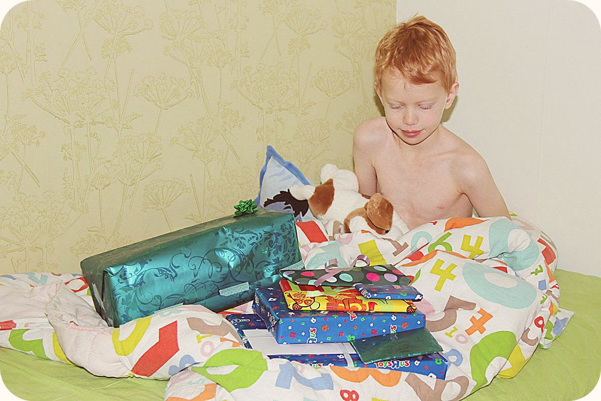 1.23, Starting his 7th year in the best of ways, with present opening in bed.
