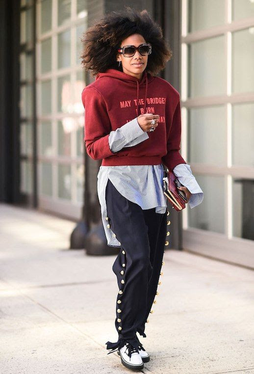 Le Fashion Blog Athleisure Trend Sunglasses Cropped Hoodie Button Up Shirt Track Pants White Boots Via Stylecaster