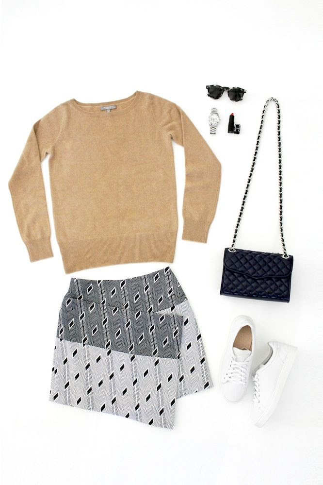 Le Fashion Blog How To Style A Statement Piece Camel Sweater Illesteva Round Sunglasses Quilted Bag Asymmetrical Printed Skirt White Sneakers Casual Cool Fall Style
